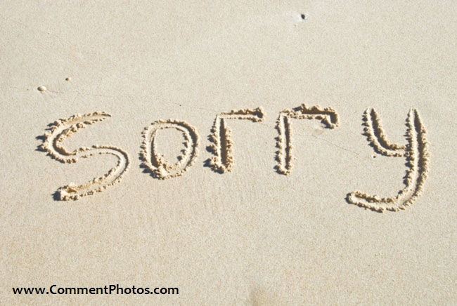 Sorry written on Beach sand